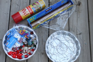 We also used: round aluminum cake pans and embellishments from the Dollar Store, cellophane wrap, cooking spray, and colourful button letters from Michael's.