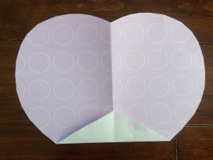 Fold the bottom tip of the heart up, creating a straight edge on the bottom.