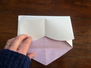 Fold the top of the heart down to meet the crease from the first fold.