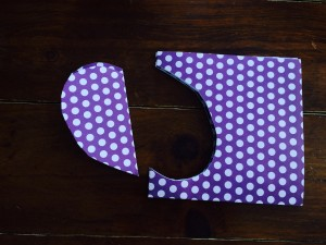Cut a half a heart shape along the double folded edge to create 2 symmetrical heart shapes.